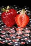 Strawberries and Glass Beads Royalty Free Stock Photos
