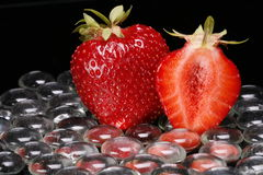 Strawberries and glass beads Royalty Free Stock Images