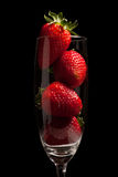 Strawberries in a glass on black background Royalty Free Stock Photo