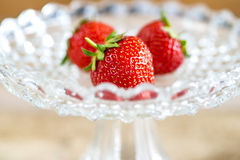 Strawberries in a glass bowl Stock Images