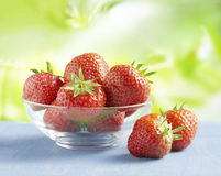 Strawberries in a glass bowl on a table outside Royalty Free Stock Photography