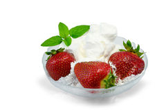 Strawberries in glass  bowl. Strawberries with whipped cream in glass  bowl over white background Royalty Free Stock Image