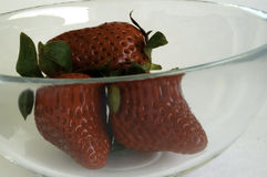 Strawberries in glass cup Stock Photos