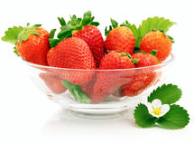Strawberries in glass dish. Strawberries with flower in glass dish Royalty Free Stock Image