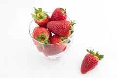 Strawberries in the glass. Few strawberries in the glass on white bachground stock image