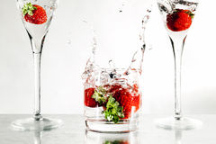 Strawberries in a glass filled with water Royalty Free Stock Photo