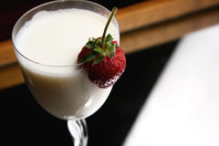 Strawberries in a glass with milk Royalty Free Stock Photography