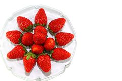 Strawberries on glass plate Stock Images