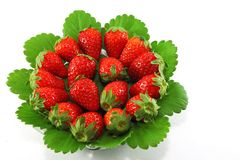 Strawberries on glass plate Stock Photos
