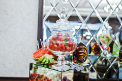 Strawberries in a glass vessel with watermelon on wedding recept Stock Photos