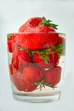 Strawberries in a glass with water Stock Photography
