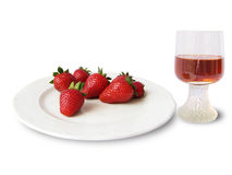 Strawberries and glass of wine Royalty Free Stock Images