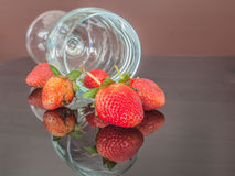 Strawberries and glass wine Stock Photography