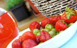 Strawberries, gooseberry, basket and compote Stock Image