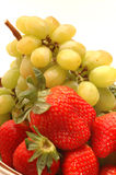 Strawberries grapes royalty free stock photos
