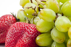 Strawberries and Grapes Stock Images