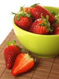 Strawberries in a green bowl, closeup Royalty Free Stock Photos