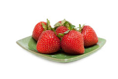 Strawberries on green chinese saucer royalty free stock photography