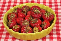 Strawberries in a green dish stock images