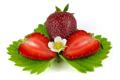 Strawberries on green leaf isolated on white Royalty Free Stock Image