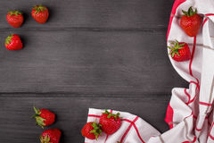 Strawberries with green leaf on white wooden. Strawberries with a towel on white wooden background Royalty Free Stock Image