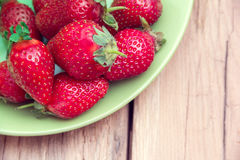 Strawberries on a green plate Royalty Free Stock Images