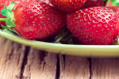Strawberries on a green plate Stock Images
