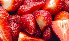 Strawberries. Group of fresh organic sliced strawberries as background royalty free stock image