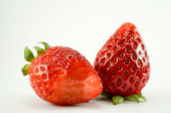 2 strawberries. Have white background.One strawerry is eaten.You can see it closeup with macro Royalty Free Stock Image