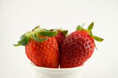 3 strawberries. Have white background.Red color stand and cut white background Royalty Free Stock Image