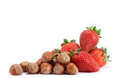 Strawberries and hazelnuts Stock Photography