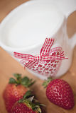 Strawberries and heart cup Stock Photos