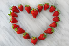 Strawberries heart. Fresh strawberries heart on marble top Royalty Free Stock Photography