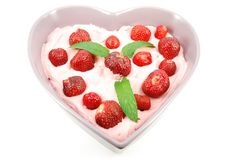 Strawberries in heart shape plate Royalty Free Stock Photo