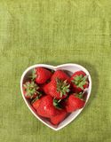 Strawberries in a heart shaped bowl Stock Photography