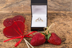 Strawberries, heart shaped candies and diamond ring Royalty Free Stock Image