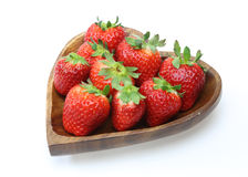 Strawberries on the heart shaped plate Stock Images