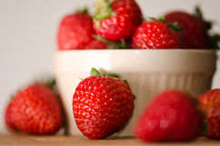 Strawberries. A high key photo of an overflowing bowl of fresh, whole strawberries Royalty Free Stock Photography