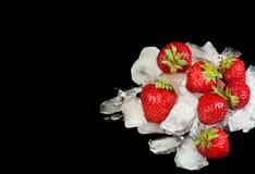 Strawberries and ice Stock Photos