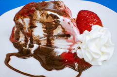 Strawberries and ice cream. Strawberries and cream, chocolate ice cream and cream Stock Image