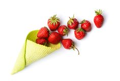 Strawberries in an ice cream cone. On white royalty free stock photography