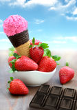 Strawberries and ice cream Stock Images