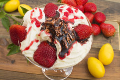Strawberries with ice cream. Strawberries and cream , strawberries on the table Royalty Free Stock Photos