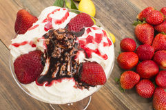 Strawberries with ice cream. Strawberries and cream , strawberries on the table Stock Photos
