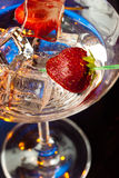 Strawberries and ice cubes in martini Royalty Free Stock Photo