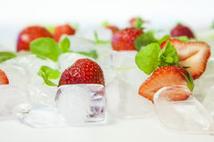 Strawberries with ice cubes and mint Royalty Free Stock Photography