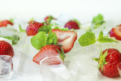 Strawberries with ice cubes and mint Royalty Free Stock Photos