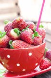 Strawberries inside a red cup Stock Images