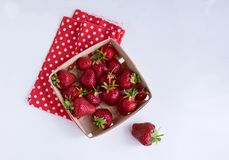 Strawberries. Isolated on a white background. Strawberries in a basket from a vine. Isolated on a white background. red in white pea cloth Stock Images