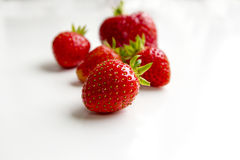 Strawberries isolated on white background. Perfectly retouched strawberry  and leaves isolated on white background with clipping path. One of the best isolated Stock Images